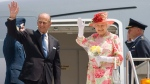 Queen Elizabeth and Prince Philip wave goodbye as they board their plane to New York at Pearson International Airport in Toronto Tuesday, July 6, 2010. THE CANADIAN PRESS/Darren Calabrese