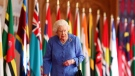 Queen Elizabeth II walks past Commonwealth flags in St George's Hall at Windsor Castle, England to mark Commonwealth Day in this image that was issued on Saturday March 6, 2021. (Steve Parsons/Pool via AP)