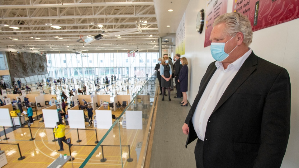 Ontario Premier Doug Ford tours a COVID-19 mass vaccination clinic in Toronto on Monday, March 8, 2021. THE CANADIAN PRESS/Frank Gunn