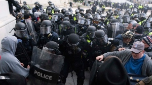 U.S. Capitol Police push back rioters trying to enter the U.S. Capitol in Washington, on  Jan. 6, 2021. (Jose Luis Magana / AP)