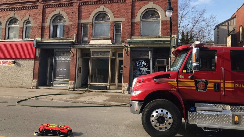 Fire crews on scene of a downtown apartment fire in West Lorne on Wednesday, March 10, 2021. (Sean Irvine / CTV London)