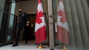 Major General Dany Fortin makes his way to a news conference Tuesday January 5, 2021 in Ottawa. THE CANADIAN PRESS/Adrian Wyld