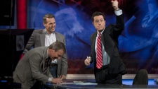 "This photo provided by Comedy Central shows left foreground, U.S. Speedskating executive director Robert Crowley, Olympic gold medalist Dan Jansen and host Stephen Colbert on the set of 'The Colbert Report"" Monday night Nov. 2, 2009 in New York."