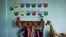 Children's backpacks and shoes are seen at a daycare in Langley, B.C., on Tuesday May 29, 2018. Ten thousand Quebec unionized home daycare workers began the first of a series of rotating strikes on Tuesday, after negotiations between their union and the province failed to produce a deal. THE CANADIAN PRESS/Darryl Dyck