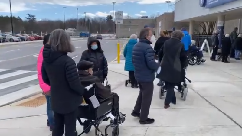 People lined up at the Nepean Sportsplex ahead of the mass vaccination site there opening Friday afternoon. People aged 90 and older are eligible to be vaccinated there. (Jeremie Charron/CTV News Ottawa)
