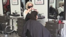 A client gets a haircut at Total Hair and Body Care in Petrolia, Ont. on March 13, 2021. (Brent Lale/CTV London)