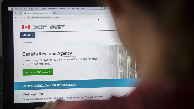 A person looks at a Canada Revenue Agency homepage in Montreal, Sunday, August 16, 2020, as the COVID-19 pandemic continues in Canada and around the world. THE CANADIAN PRESS/Graham Hughes