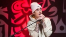 Canadian singer Justin Bieber performs live during a small concert for charity in Toronto on Monday, December 7, 2015. THE CANADIAN PRESS/Nathan Denette