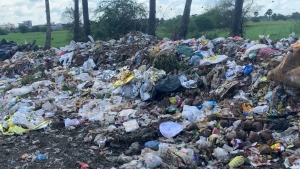 Plastic pollution along the roadway in Indonesia. Most of it ends up in open landfills and is burned or blown away into waterways.