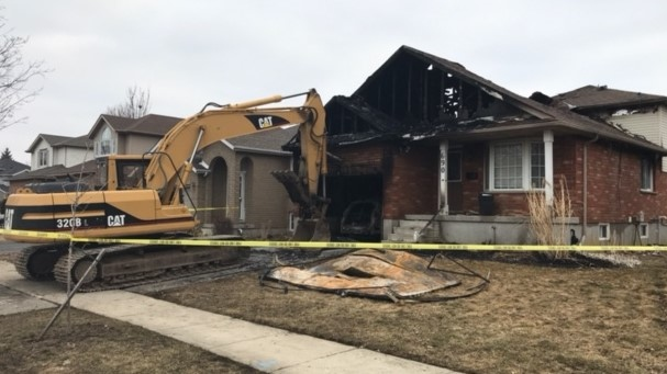 An excavator sits ready to work on a Waterloo house that had caught on fire. (Chris Thomson/CTV Kitchener) (Mar. 17, 2021)