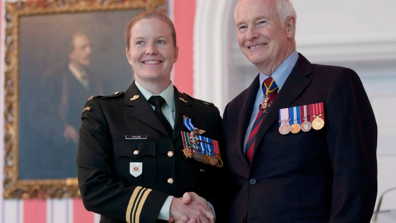 Governor General David Johnston presents Major Eleanor Taylor, from Antigonish, N.S. with the Meritorious Service Medal during a ceremony in Ottawa, Ont. Friday June 22, 2012. THE CANADIAN PRESS/Adrian Wyld