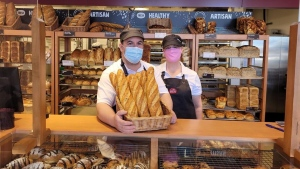 Bakery owners Mike Livingstone and Annie Hoare, shown in this March 2021 handout image, opened the first COBS Bread bakery in Georgetown, Ont., in December. THE CANADIAN PRESS/HO