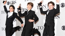 Canadian David Alvarez, left, Kiril Kulish, and Trent Kowalik, right, jump with their trophies for Best Performance by a Leading Actor in a Musical for 'Billy Elliot, The Musical' at the 63rd Annual Tony Awards in New York, June 7, 2009. Another Canadian, Liam Redhead, has been cast in the role. (AP / David Goldman)