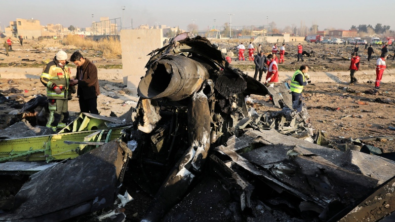 In this Jan. 8, 2020, file photo, debris at the scene where a Ukrainian plane crashed in Shahedshahr southwest of the capital Tehran, Iran. (AP / Ebrahim Noroozi, File)