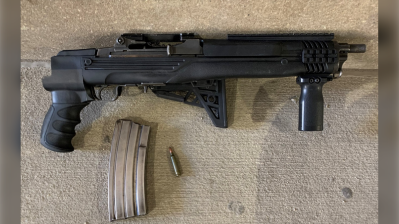A loaded Ruger Mini-14, .223 rifle with a folding stock and a high-capacity magazine was recently seized by the Winnipeg police. (Image source: Winnipeg Police Service handout)