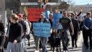 A crowd of up to 300 people march in Victoria Park, continuing down Richmond Street - Saturday, March 20, 2021 (Jim Knight / CTV News)