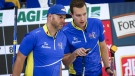 Team Alberta skip Brendan Bottcher, right, and third Darren Moulding discuss strategy as they play Team Wild Card Two during the Brier curling final in Calgary, Alta., Sunday, March 14, 2021. THE CANADIAN PRESS/Jeff McIntosh
