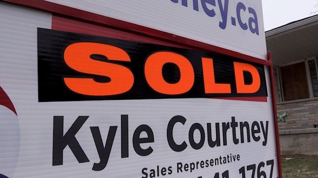 House sale sign in Exeter Ont, seen on Sunday March 21, 2021 (Scott Miller/CTV News)