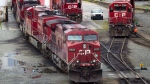 A Canadian Pacific Rail maintenance worker climbs onto a locomotive at the company's Port Coquitlam yard east of Vancouver, B.C., on Wednesday May 23, 2012. THE CANADIAN PRESS/Darryl Dyck