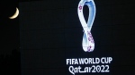 The 2022 Qatar World Cup logo is projected on the opera house of Algiers, Tuesday Sept.3, 2019. Flashed on big screens and projected onto landmarks worldwide, the 2022 Qatar World Cup logo was revealed Tuesday with a design that reflects both the tournament's compact infrastructure and winter schedule. (AP Photo/Toufik Doudou)