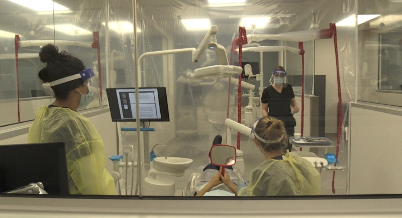 Students work in the new oral health clinic at Fanshawe College in London, Ont. on Wednesday, March 17, 2021. (Jordyn Read / CTV News)
