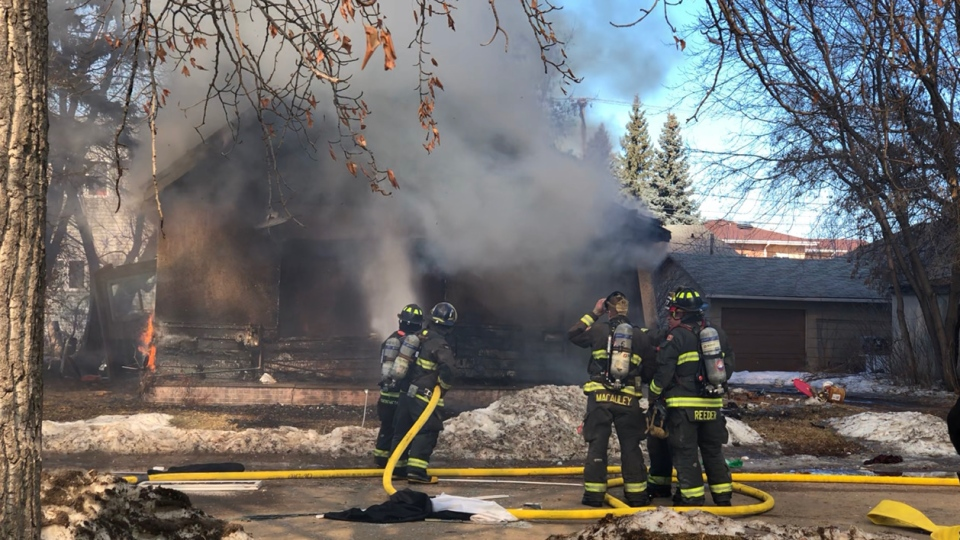 Fire fighters battled a blaze in the 500 block of 5th Street East. (Lisa Risom/CTV News)