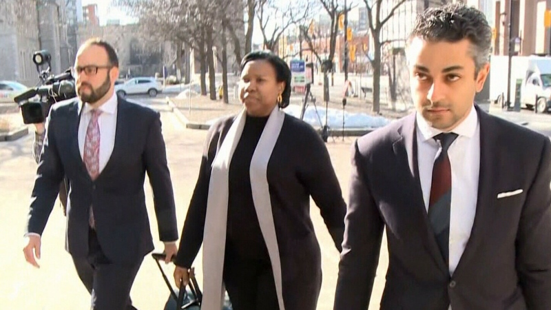 Aissatou Diallo, middle, approaches the courthouse in Ottawa as the criminal trial for the fatal bus crash at the Westboro bus station begins March 22, 2021. Diallo, 44, was charged in August 2019 with three counts of dangerous driving causing death, and 35 counts of dangerous driving causing bodily harm.