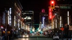 A nearly empty Granville Street entertainment district is seen just before 10 p.m. on St. Patrick's Day in downtown Vancouver, on Wednesday, March 17, 2021. (Darryl Dyck / THE CANADIAN PRESS)