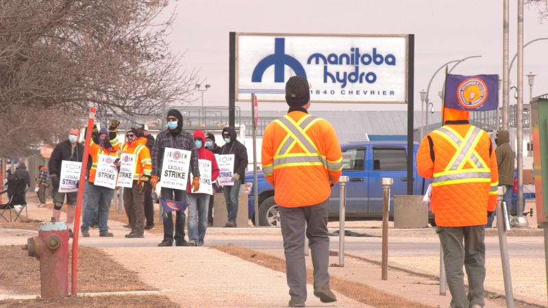 Members of The International Brotherhood of Electrical Workers (IBEW) Local 2034 walk the picket line on March 23, 2021, after declaring a general strike. (CTV News Winnipeg/ Glenn Pismenny)