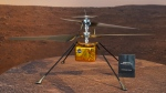 This Wednesday, Feb. 17, 2021 file photo shows a full-scale model of the Ingenuity helicopter displayed for the media at NASA's Jet Propulsion Laboratory in Pasadena, Calif. (AP Photo/Damian Dovarganes)