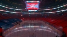The clock at the Bell Centre shows graphics before the postponement of an NHL hockey game between the Montreal Canadiens and the Edmonton Oilers, in Montreal, Monday, March 22, 2021. THE CANADIAN PRESS/Paul Chiasson