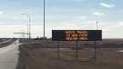 A sign on Highway 11 warns people to avoid travel to and from the Regina area. The Government of Saskatchewan put a travel advisory into effect for Regina and surrounding areas on March 23, 2021. (Katy Syrota/CTV News)