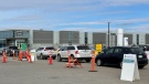 Vehicles are seen lined up at Regina's drive-thru COVID-19 testing site, on March 24, 2021. (Marc Smith/CTV News)