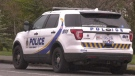 An Oak Bay Police vehicle is parked outside the home police searched Wednesday in relation to the murder investigation. (CTV News)