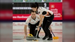 Brad Gushue and Kerry Einarson of Team Einarson/Gushue play a shot during their 11-2 win over Jones/Laing during the Canadian Mixed Double Curling Championship Calgary on Wednesday, March 24, 2021. THE CANADIAN PRESS/HO - Curling Canada, Michael Burns