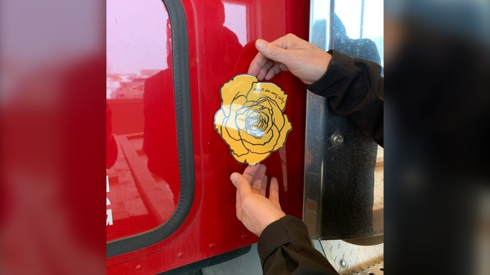 Truckers are encouraged to put yellow rose decals on their rigs to indicate they can help human trafficking victims. (Courtesy: AMTA)