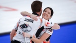 Team Einarson/Gushue skip Kerri Einarson, right, and third Brad Gushue celebrate defeating Team Schmiemann/Morris in the semi-final at the Canadian Mixed Doubles Curling Championship in Calgary, Alta., Thursday, March 25, 2021.THE CANADIAN PRESS/Jeff McIntosh
