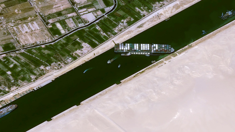 This satellite image from Cnes2021, Distribution Airbus DS, shows the cargo ship MV Ever Given stuck in the Suez Canal near Suez, Egypt, Thursday, March 25, 2021. (Cnes2021, Distribution Airbus DS via AP)