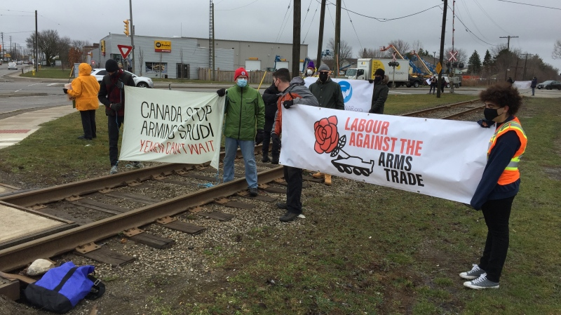 Activists protesting the sale of arms to Saudi Arabia block a railway line near General Dynamics Land Systems in London, Ont. on Friday, March 26, 2021. (Bryan Bicknell / CTV News)