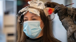 Amy Doyle wears a mask to protect her from the COVID-19 while getting a cut and colour at FAB hair in Kingston, Ontario, on Wednesday Feb. 10, 2021.THE CANADIAN PRESS/Lars Hagberg