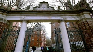 In this Dec. 13, 2018, file photo, a gate opens to the Harvard University campus in Cambridge, Mass. (AP Photo/Charles Krupa, File)