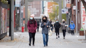 People make their way along a street in Chinatown in Montreal, Sunday, November 1, 2020. A new report from the Montreal police show hate crimes related to race rose by 53 per cent in 2020. THE CANADIAN PRESS/Graham Hughes