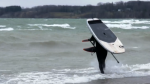 A foil surfer takes advantage of the high winds and waves of Lake Erie in Port Dover, Ont. on Friday, March 26, 2021. (Marek Sutherland / CTV News)