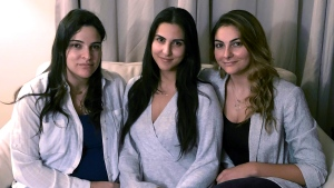 In this Nov. 5, 2019, photo, from left, Guila, Macy and Zoya Fakhoury, three of Amer Fakhoury's four daughters, gather in Salem, N.H. (AP Photo/Kathy McCormack)
