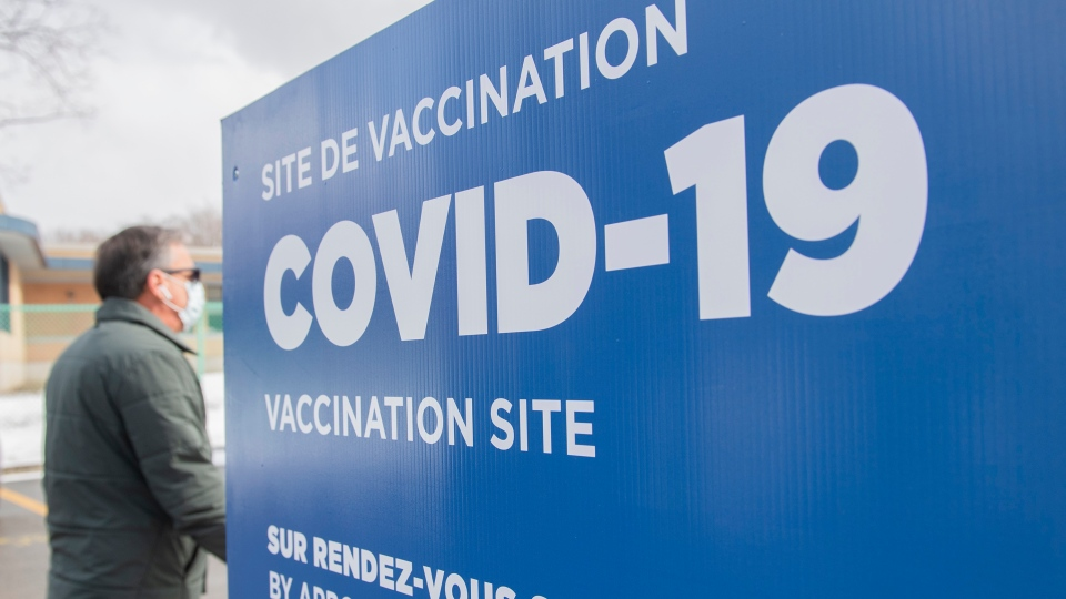 A man is shown arriving at a COVID-19 vaccination site in Montreal, Sunday, March 14, 2021, as the COVID-19 pandemic continues in Canada and around the world. THE CANADIAN PRESS/Graham Hughes