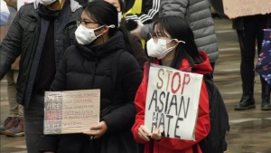 People gather at an anti-Asian hate crime rally in Vancouver on March 27, 2021.