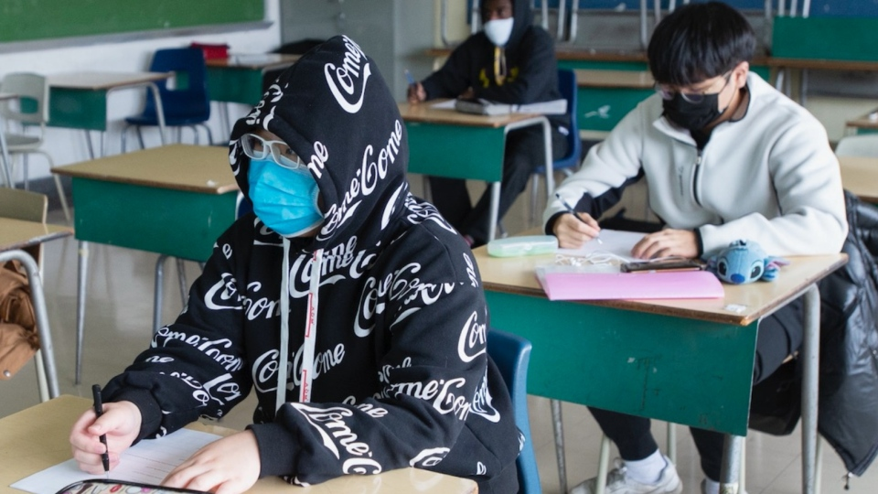 High school students at Marymount Academy International wear masks as they attend class Tuesday, November 17, 2020 in Montreal. THE CANADIAN PRESS/Ryan Remiorz