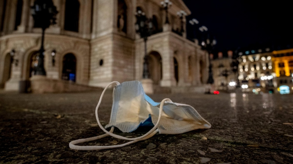 A face mask was left back on the square in front of the Old Opera in Frankfurt, Germany, on March 29, 2021. (Michael Probst / AP)