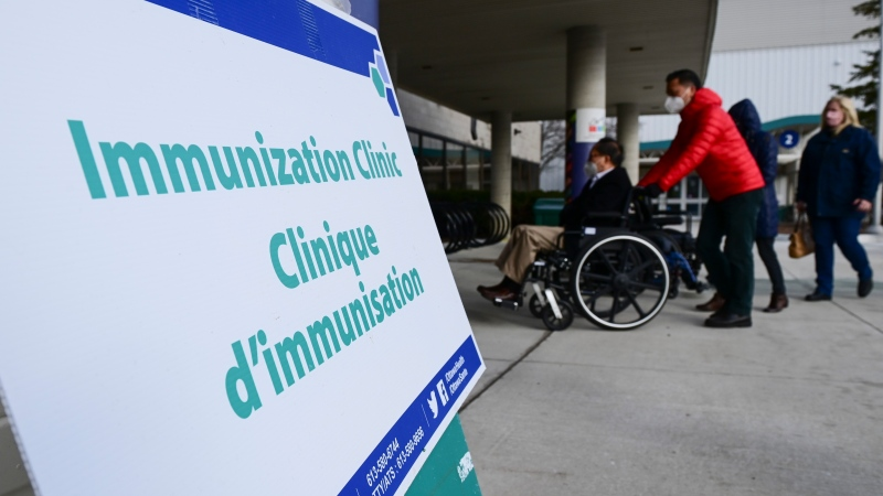 People arrive for their vaccine appointment time at a COVID-19 clinic in Ottawa on Tuesday, March 30, 2021. (Sean Kilpatrick/THE CANADIAN PRESS)