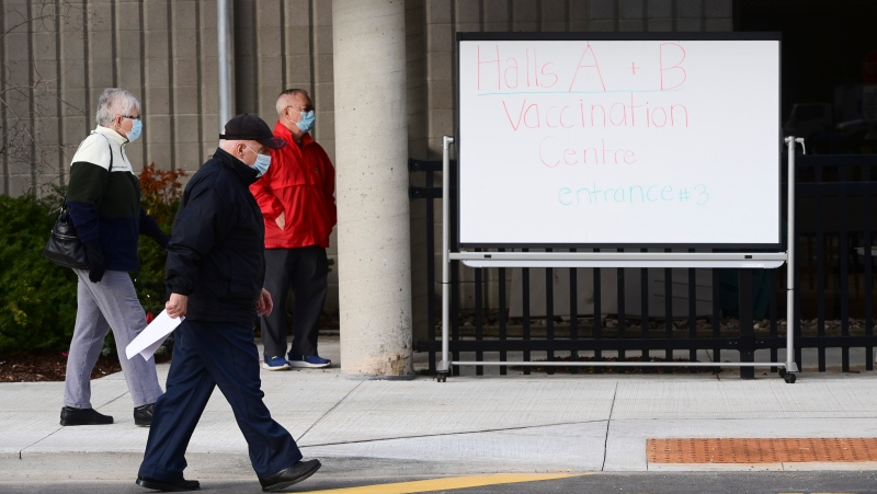 People wait for their appointment time to be called at a COVID-19 clinic in Ottawa on Tuesday, March 30, 2021. (Sean Kilpatrick/THE CANADIAN PRESS)
